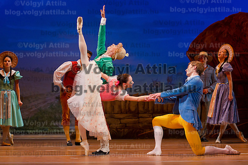 Dancer Bela Balogh (left), Adrienn Pap (center) and Zoltan Olah (right)perform in the dance piece La Fille Mal Gardee or The Wayward Daughter Choreographed by Sir Frederick Ashton presented by the Hungarian National Ballet Company in Hungary State Opera House,  Budapest, Hungary, Tuesday, 23. November 2010. ATTILA VOLGYI