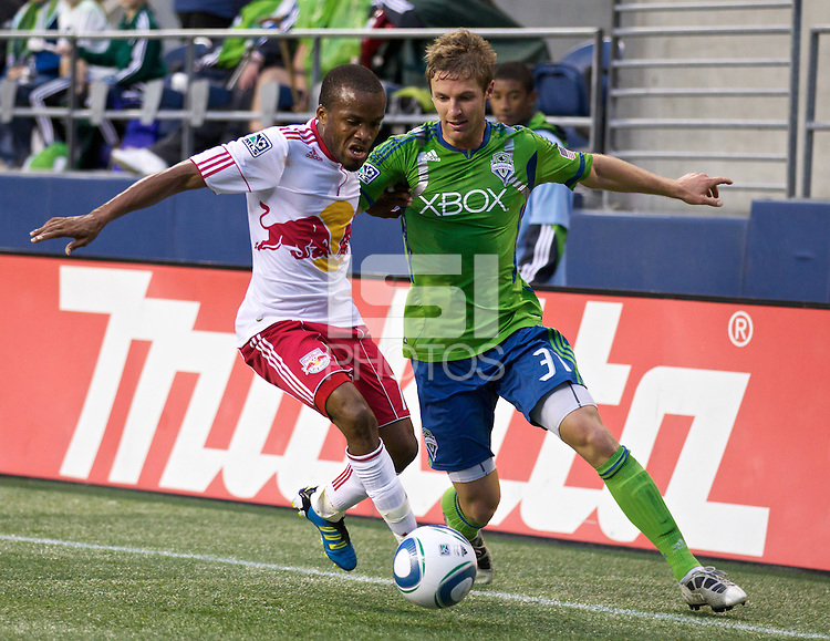 New York Red Bulls forward Dane Richards and Seattle Sounders FC defender Jeff Parke battle for the ball during play between the Seattle Sounders FC and the New York Red Bulls at Qwest Field in Seattle Saturday June 23, 2011. The Sounders won the game 4-2.