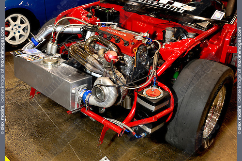 Custom car engine. Red Honda without bumper hood and fenders.