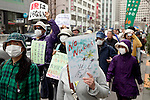 """March 10, 2013, Tokyo, Japan -  Anti-nuclear protesters hold placards during a """"Zero Nukes"""" rally in downtown Tokyo. The day before the second-year anniversary of the Great East Japan Earthquake and TEPCO Fukushima Daiichi nuclear power plant accident of March 11, 2011. The rally is held by Metropolitan Coalition Against Nukes which was formed in September 2011. (Photo by Rodrigo Reyes Marin/AFLO).."""