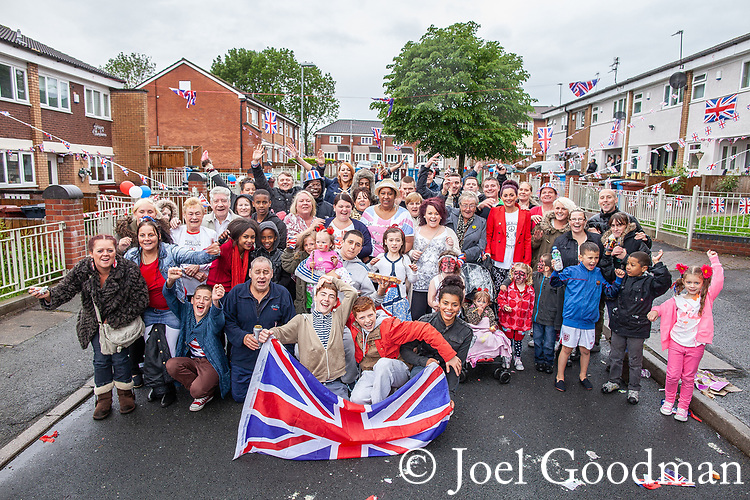 © Joel Goodman - 07973 332324 . 03/06/2012 . Manchester , UK . Jubilee party featuring the residents of Farnborough Road , Winstandley Road end , Miles Platting , as streets are closed for street parties for the Queen's Diamond Jubilee celebrations . Photo credit : Joel Goodman