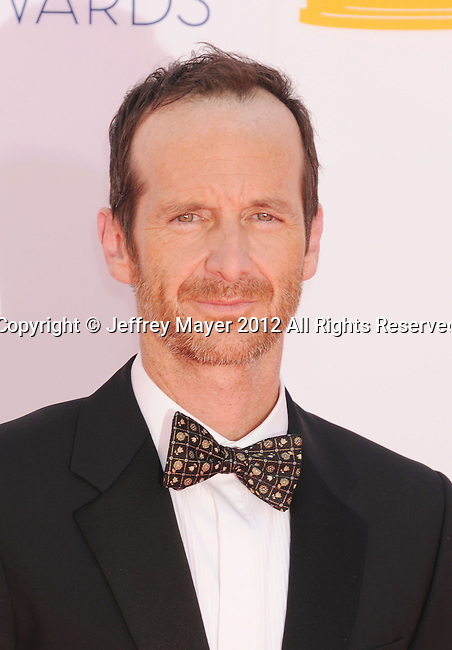 LOS ANGELES, CA - SEPTEMBER 23: Denis O'Hare. arrives at the 64th Primetime Emmy Awards at Nokia Theatre L.A. Live on September 23, 2012 in Los Angeles, California.