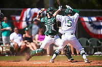 Dartmouth Big Green catcher Adam Gauthier (18) throws down to second base to catch a runner attempting to steal as batter Drake Peggs (5) avoids contact during a game against the Eastern Michigan Eagles on February 25, 2017 at North Charlotte Regional Park in Port Charlotte, Florida.  Dartmouth defeated Eastern Michigan 8-4.  (Mike Janes/Four Seam Images)