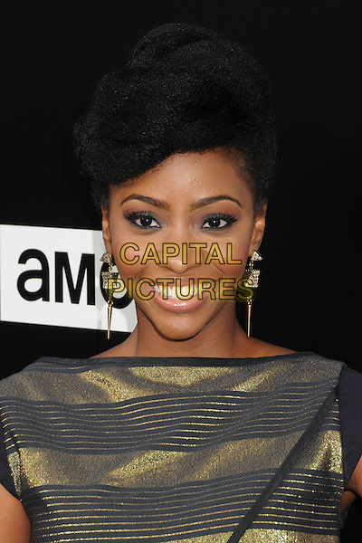 Teyonah Parris<br /> &quot;Breaking Bad&quot; Final Episodes Los Angeles Premiere Screening held at Sony Pictures Studios, Culver City, California, USA, 24th July 2013.<br /> portrait headshot gold black striped earrings smiling <br /> CAP/ADM/BP<br /> &copy;Byron Purvis/AdMedia/Capital Pictures