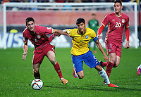 Serbia's Sasa Zdjelar (4) tries to hold off Brazil captain Danilo during the FIFA Under-20 Football World Cup Final between Brazil (gold) and Serbia at North Harbour Stadium, Albany, New Zealand on Saturday, 20 June 2015. Photo: Dave Lintott / lintottphoto.co.nz