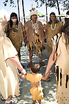 The Tongva Nation Dancers gather for a blessing before dancing at Moompetam at the Aquarium of the Pacific, Long Beach, CA