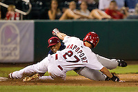 James Rapoport (27) of the Springfield Cardinals slides into third base during a game against the Northwest Arkansas Naturals at Hammons Field on August 1, 2011 in Springfield, Missouri. Springfield defeated Northwest Arkansas 7-1. (David Welker / Four Seam Images)