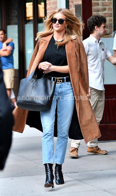 www.acepixs.com<br /> <br /> September 16 2016, New York City<br /> <br /> Model Rosie Huntington-Whiteley left her downtown hotel on September 16 2016 in New York City<br /> <br /> By Line: Curtis Means/ACE Pictures<br /> <br /> <br /> ACE Pictures Inc<br /> Tel: 6467670430<br /> Email: info@acepixs.com<br /> www.acepixs.com