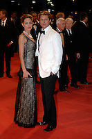 ANGELINA JOLIE &amp; BRAD PITT<br /> Premiere of &quot;The Assassination of Jesse James by the Coward Robert Ford&quot; at the 64th Venice Film Festival (La Biennale di Venezia), Venice, Italy.<br /> September 2nd, 2007<br /> full length long black lace layered dress maxi clutch bag pearl necklace couple cream white tuxedo jacket shirt suit black trousers bow tie  hand in pocket <br /> Ref: CAP/PL<br /> &copy;Phil Loftus/Capital Pictures /MediaPunch ***NORTH AND SOUTH AMERICAS ONLY***