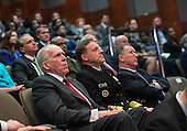 CIA Director John Brennan (L) and Director of the National Security Agency Mike Rogers listen as President Barack Obama speaks at a ceremony marking the 10th anniversary of the formation for the Office of the Director of National Intelligence, at it's headquarters on April 24, 2015 in McLean, Virginia. <br /> Credit: Kevin Dietsch / Pool via CNP