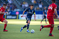 """CARSON, CA - FEBRUARY 15: Javier """"Chicharito"""" Hernandez #14 of the Los Angeles Galaxy dribbles the ball during a game between Toronto FC and Los Angeles Galaxy at Dignity Health Sports Park on February 15, 2020 in Carson, California."""