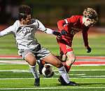 CBC defender Alexander Peters (left) and Kirkwood midfielder Sawyer Hardy tangle as they fight for the ball, with both of them falling to the turf a moment later. CBC played Kirkwood in a Class 4 sectional soccer game at Kirkwood High School in Kirkwood on Thursday November 14, 2019.<br /> Tim Vizer/Special to STLhighschoolsports.com