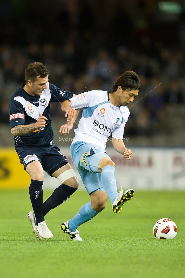 MELBOURNE, AUSTRALIA - OCTOBER 16, 2010: Billy Celeski of Melbourne Victory and Hirofumi Moriyasu of Sydney FC fight for the ball in Round 10 of the 2010 A-League between the Melbourne Victory and Sydney FC at Etihad Stadium on October 16, 2010 in Melbourne, Australia. (Photo by Sydney Low / Asterisk Images)