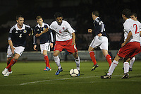 Massimo Maritino clears from Danny Wilson in the Scotland v Luxembourg UEFA Under 21 international qualifying match at St Mirren Park, Paisley on 6.9.12.