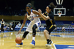 05 November 2015: Duke's Amber Henson (30) and Pfeiffer's Shontai Totten (right). The Duke University Blue Devils hosted the Pfeiffer University Falcons at Cameron Indoor Stadium in Durham, North Carolina in a 2015-16 NCAA Women's Basketball Exhibition game. Duke won the game 113-36.