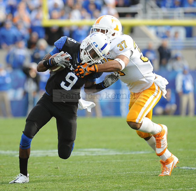 UK Wide Receiver Demarco Robinson being tackled by Tennessee Safety Brian Randolf on a reverse during the third quarter of the University of Kentucky football game against Tennessee at Commonwealth Stadium in Lexington, Ky., on 11/26/11. UK won the game 10-7. Photo by Bob Weaver | Staff
