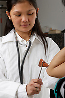 Model Released photos (simulation)<br /> of Filipina Nurses testing a patient reflexes with a rubber hammer.<br /> <br /> Photo : Pierre Roussel -  Images Distribution