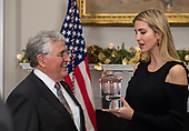 Ivanka Trump, advisor to United States President Donald J. Trump, touches a stone from the moon that former astronaut Jack Schmitt, left, collected during the Apollo 17 mission, just after President Trump signed the Presidential Space Directive - 1, directing NASA to return to the moon, in the Roosevelt Room of the White House in Washington, Monday, Dec. 11, 2017. <br /> Mandatory Credit: Aubrey Gemignani / NASA via CNP