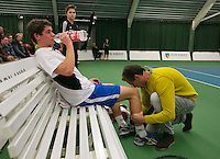 18-01-14,Netherlands, Rotterdam,  TC Victoria, Wildcard Tournament,    Ton Smit (NED) gets medical treatment<br /> Photo: Henk Koster