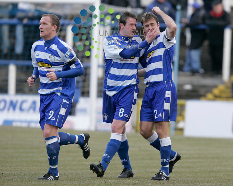 Ryan McGuffie of Morton scores (No2)and celebrates with teammate Allan Jenkins  during the Morton v Dunfermline Athletic, Scottish Football League, Cappielow Park Greenock..27 February 2010 Picture: Universal News And Sport (Scotland)..