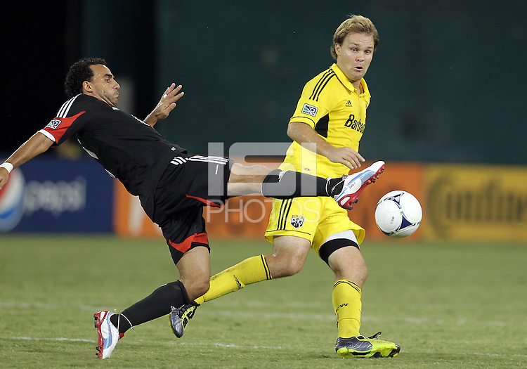 WASHINGTON, DC - AUGUST 4, 2012:  Dwayne DeRosario (7) of DC United boots the ball away from Chad Marshall (14) of the Columbus Crew during an MLS match at RFK Stadium in Washington DC on August 4. United won 1-0.