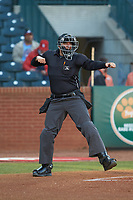 Home plate umpire Ben Fernandez calls a batter out on strikes during the South Atlantic League game between the Augusta GreenJackets and the Greensboro Grasshoppers at First National Bank Field on April 10, 2018 in Greensboro, North Carolina.  The GreenJackets defeated the Grasshoppers 5-0.  (Brian Westerholt/Four Seam Images)