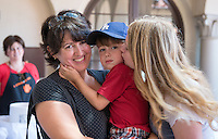 From left, Occidental College Theater Department technical director Aubree Cedillo holds her son, Guthrie (possibly class of 2034?) as her daughter Cassie Fitzmorris '19 gives him a kiss during the Ice Cream Social and Goodbyes in the Samuelson Alumni Center, Orientation, Aug. 23, 2015.<br />