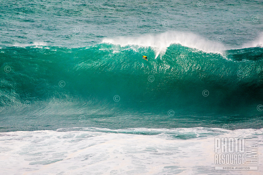 "Surfer Grant ""Twiggy"" Baker free falling from the top of a wave at the 2016 Big Wave Eddie Aikau Contest, Waimea Bay, North Shore, O'ahu."
