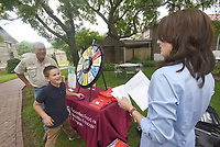 NWA Democrat-Gazette/FLIP PUTTHOFF <br /> MASTER GARDENERS' ANNIVERSARY<br /> Johnny Gunsaulis (left) and his son, Haden, 9, answer questions from Cathy Love about nutrition during a game on Tuesday at the Benton County Master Gardeners 25th anniversary held at the Peel Mansion in Bentonville. Festivities included games, food, prize drawings and music by the duo Still on the Hill. Benton County Master Gardeners maintain public gardens around the area and offer training for gardeners, said Donald Casteel, vice-president in charge of projects. The group is under the wing of the University of Arkansas Cooperative Extension Service. Johnny Gunsaulis and Love are with the UA Cooperative Extension Service.
