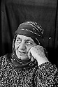 "Zubeyda Ali, 60, who fled Kobani with her whole family, including ten married children and 25 grandchildren, was tattooed at the age of 13. She has a large tattoo on her left hand and some small inverted ""v"" tattoos on her chin. Her husband, Nuh Shahin, says ""all the men loved girls with tattoos."" They married when she was 13 and he was 20."