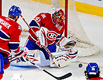 20 December 2008: Montreal Canadiens' goaltender Jaroslav Halak from the Slovak Republic makes a first period save against the Buffalo Sabres at the Bell Centre in Montreal, Quebec, Canada. With both teams coming off wins, the Canadiens extended their winning streak by defeating the Sabres 4-3 in overtime. ***** Editorial Sales Only ***** Mandatory Photo Credit: Ed Wolfstein Photo