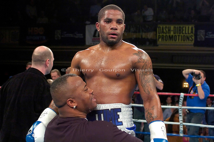 Curtis Stevens in the  the ring after his  8 rounds Super Middleweight fight against Jose Spearman (purple trunk) at the Hammerstein Ballroom in New York city on 02.16.2006..Stevens won by TKO in the 2nd.