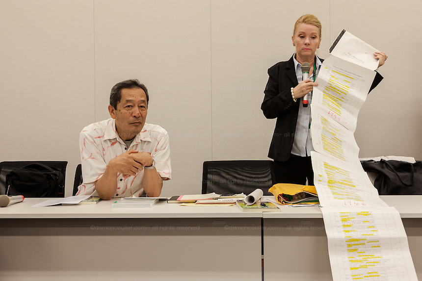 "Rape Survivor and activist, Catherine ""Jane"" Fisher (right) shows a 6 metre long list of sexual crimes against women that have taken place in Okinawa since 1945 at a press conference to publicise her book in the First Office Building of the Members of the House of Representatives, Nagatacho, Tokyo, Japan, Friday July 18th 2014. Ms Fisher was raped near Yokosuka US Naval Base in Kanagawa in 2002 and has been campaign for the rights of rape victims in Japan since after finding the US Military and Japanese police obstructive and uninterested in bringing her attacker to justice."