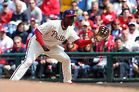 Philadelphia Phillies first baseman John Mayberry #15 takes a throw during their home opener against the Miami Marlins at Citizens Bank Park on April 9, 2012 in Philadelphia, Pennsylvania.  Miami defeated Philadelphia 6-2.  (Mike Janes/Four Seam Images)