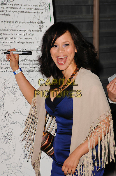 ROSIE PEREZ.The 6th Annual Global Green USA Pre-Oscar Party benefiting Green Schools held at Avalon in Hollywood, California, USA. .February 19th, 2009 .half length purple blue silk satin dress mouth open signing autograph beige knitted wrap shawl .CAP/ROT.©Lee Roth/Roth Stock/Capital Pictures