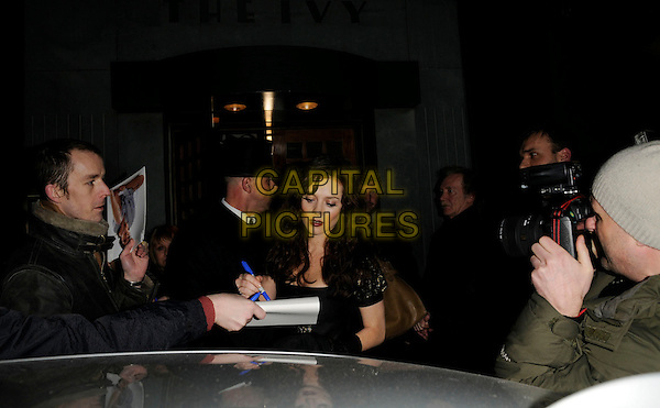 ANNA FRIEL .At The Ivy Restaurant, London, England,.February 2nd 2008..half length getting into car red lipstick fan signing autograph hunters photographer.CAP/CAN.?Can Nguyen/Capital Pictures