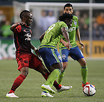 Seattle Sounders Obafemi Martins (9) controls the ball away from  Portland Timbers Ishmael Yartey (18) during an MLS match on April 26, 2015 at CenturyLink Field in Seattle, Washington.  Seattle Sounders Clint Dempsey scored a goal to give the Sounders a 1-0 victory over the Timbers. Jim Bryant Photo. ©2015. All Rights Reserved.