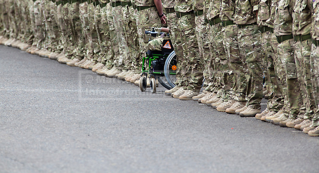 WINDSOR, UK  25/06/11. The wheelchair of triple amputee Guarsdman Lamin Manneh, who lost both legs and part of one arm in his units recent operational tour of Afghanistan, is seen line of his fellow Guardsmen during a medals parade. The First Battalion, The Irish Guards, recently returned from operation Herric in Afghanistan, were parading at their current base, Victoria Barracks, in Windsor to receive the Afghanistan Campaign Medal from the Duke and Duchess of Cambridge. Photo credit should read Matt Cetti-Roberts