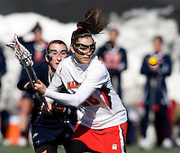 Kate Faas (26) of Maryland looks to regain possession of the ball with  Bria Eulitt (18) of Richmond close behind at the practice turf field in College Park, Maryland.  Maryland defeated Richmond, 17-7.