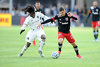 WASHINGTON, DC - FEBRUARY 29: Washington, D.C. - February 29, 2020: Joseph Mora #28 of D.C. United battles the ball with Lalas Abubakar #6 of the Colorado Rapids. The Colorado Rapids defeated D.C. Untied 2-1 during their Major League Soccer (MLS)  match at Audi Field during a game between Colorado Rapids and D.C. United at Audi Field on February 29, 2020 in Washington, DC.