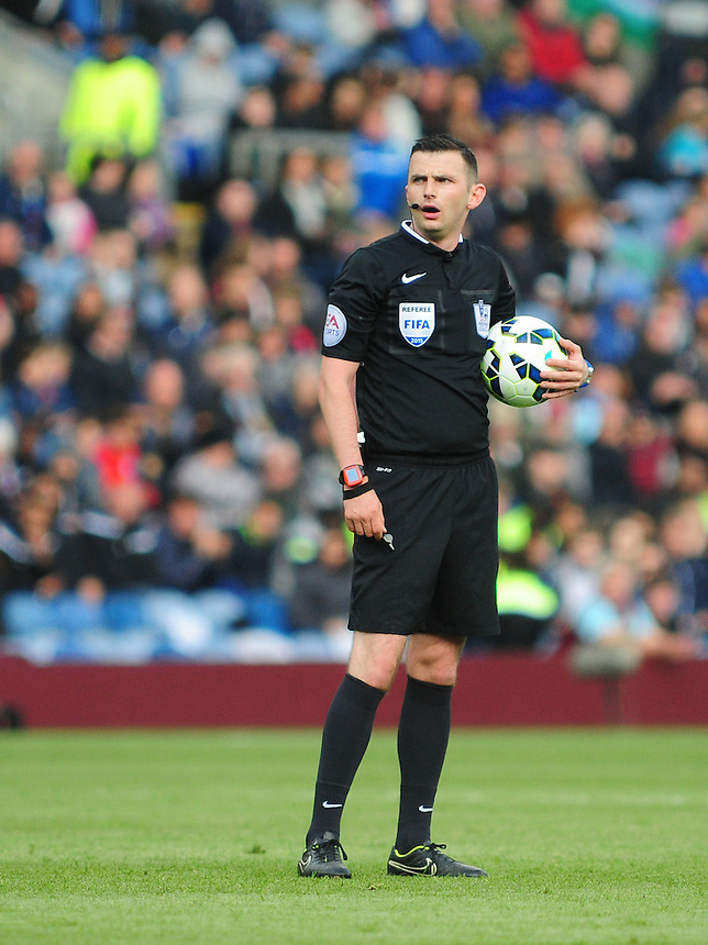 Referee Michael Oliver<br /> <br /> Photographer Andrew Vaughan/CameraSport<br /> <br /> Football - Barclays Premiership - Burnley v Stoke City - Saturday 16th May 2015 - Turf Moor - Burnley<br /> <br /> &copy; CameraSport - 43 Linden Ave. Countesthorpe. Leicester. England. LE8 5PG - Tel: +44 (0) 116 277 4147 - admin@camerasport.com - www.camerasport.com