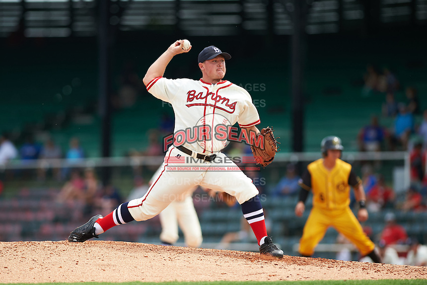 Birmingham Barons pitcher J.B. Wendelken (34) delivers a pitch during the 20th Annual Rickwood Classic Game against the Jacksonville Suns on May 27, 2015 at Rickwood Field in Birmingham, Alabama.  Jacksonville defeated Birmingham by the score of 8-2 at the countries oldest ballpark, Rickwood opened in 1910 and has been most notably the home of the Birmingham Barons of the Southern League and Birmingham Black Barons of the Negro League.  (Mike Janes/Four Seam Images)