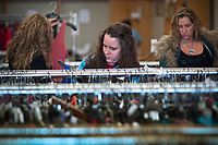 Shoppers sort through closeout specials on shoes and clothes at the MJR Sale in the form JoAnns store at Westerville Plaza Shopping center. The closeout company may be having its last sale in the closed strip center store because Wal-Mart will have the building demolished for a new store.