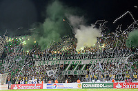 MEDELLÍN -COLOMBIA-03-12-2014. Seguidores de Atlético Nacional de Colombia muestran su apoyo a su equipo durante el encuentro de ida con River Plate de Argentina por la final en la Copa Total Sudamericana 2014 realizado en el estadio Atanasio Girardot de Medellín./ Followers of Atletico Nacional of Colombia show their support to their team during the first leg match with River Plate of Argentina for the final of the Copa Total Sudamericana 2014 played at Atanasio Girardot stadium in Medellin. Photo: VizzorImage/Luis Ríos/STR