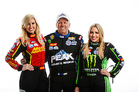 Feb 8, 2017; Pomona, CA, USA; NHRA funny car driver Courtney Force (left) with father John Force (center) and sister top fuel driver Brittany Force pose for a portrait during media day at Auto Club Raceway at Pomona. Mandatory Credit: Mark J. Rebilas-USA TODAY Sports