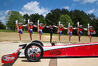 Apr 22, 2014; Kilgore, TX, USA; NHRA top fuel dragster driver Steve Torrence (center) performs with the Kilgore College Rangerettes at the Torrence estate. Mandatory Credit: Mark J. Rebilas-USA TODAY Sports