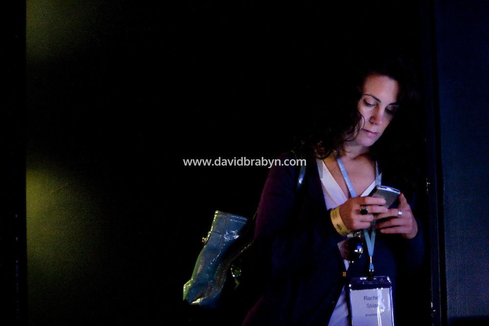 Rachel Sklar (@rachelsklar) looks at her smartphone during the 140 Character conference in New York City, USA, 16 June 2009.