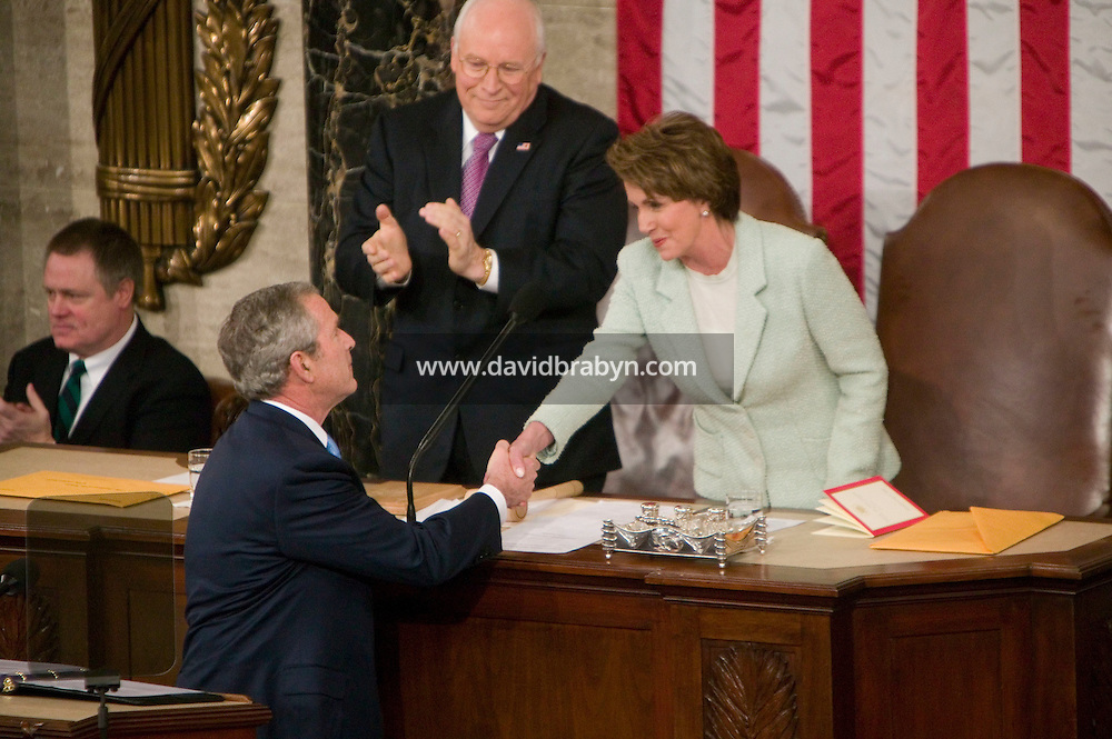 23 January 2007 - Washington, DC - US President George W. Bush (2L) shakes hands with Speaker of the House Nancy Pelosi (R) as Vice-President Cheney (2R) looks on, at the start of his State of the Union speech in Washington, DC, USA, 23 January 2007.