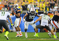 Jan 10, 2011; Glendale, AZ, USA; Auburn Tigers guard (57) Byron Isom against the Oregon Ducks during the 2011 BCS National Championship game at University of Phoenix Stadium. The Tigers defeated the Ducks 22-19. Mandatory Credit: Mark J. Rebilas-