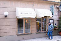 The front of the gastronomic restaurant Leijontornet (The Tower of the Lion) in Gamla Stan the Old Town. A man walking past. Stockholm, Sweden, Sverige, Europe